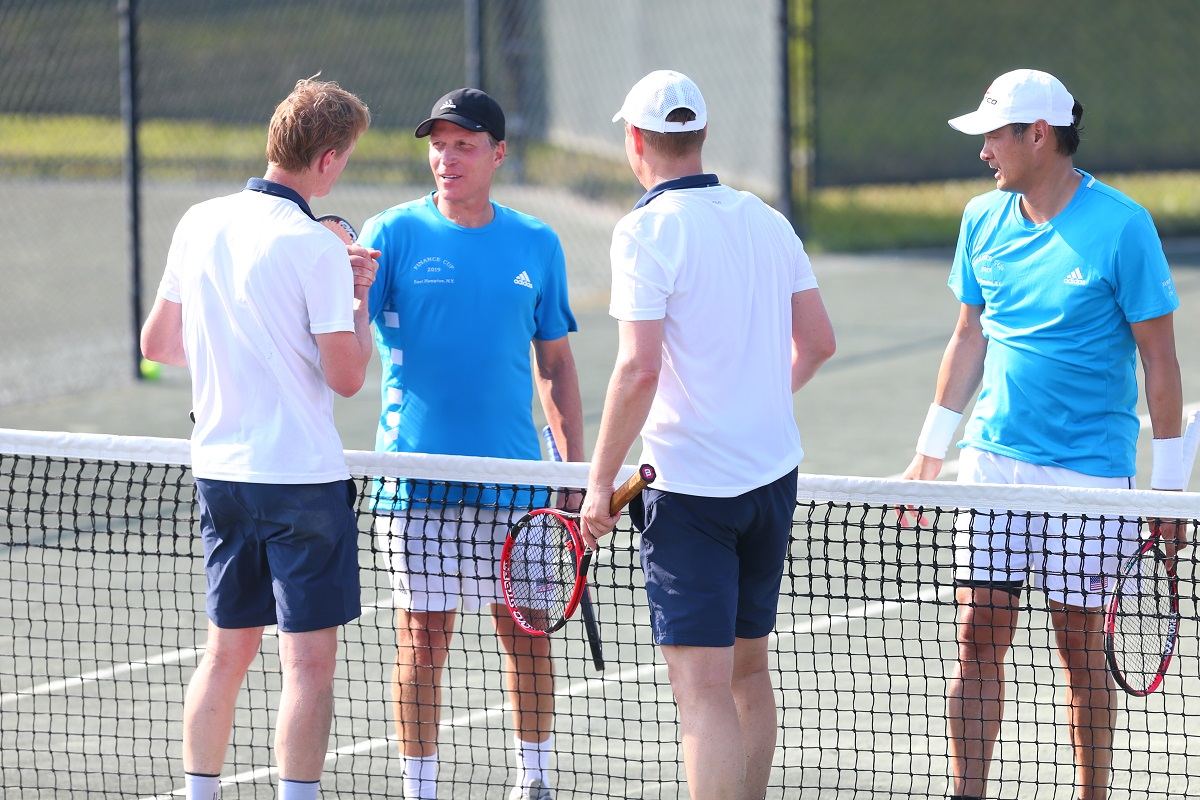 Team USA's Richey Reneberg (left) and Albert Chang (right) shake hands with Team Europe's Hendrik Jan Davids (left) and Stephen Noteboom (right).