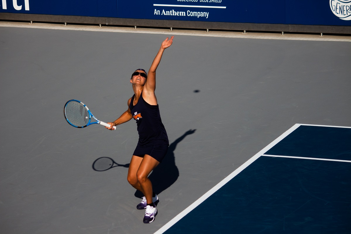 Kirsten Flipkens returned to the New York Empire on Wednesday night and won the decisive match at women's singles to propel her team into the World TeamTennis playoffs.