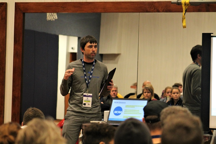 USTA's Collegiate Tennis Manager Brian Ormiston talks during his seminar that included college coaches.