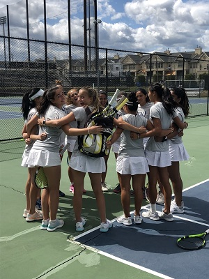 The College of New Jersey tennis team huddles up before a match last season.