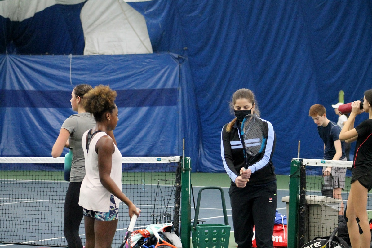Anna Tatishvili coaching at a Cary Leeds Center Academy practice session.