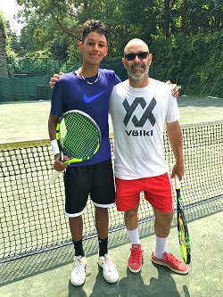 Julian Joaquin Vasquez with coach Gilad Bloom at the Riverdale Tennis Center.