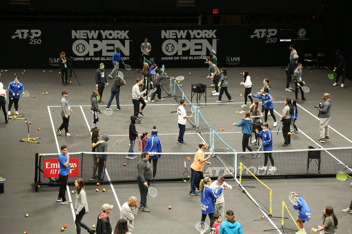 The 2020 New York Tennis Expo featured a large tennis clinic for kids with Autism taught by local high school and college players, as well as legendary coach Nick Bollettieri.