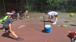 John Walentowicz  on court with the kids in his summer program. Walentowicz brought free tennis programming to Passaic, N.J. this past summer, and has plans to continue growing it this year.