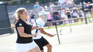 Kim Clijsters playing at the annual Johnny Mac Tennis Project Pro-Am earlier this summer.