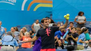 Roger Federer gets ready to hit balls into the crowd at last year's Arthur Ashe Kids Day.