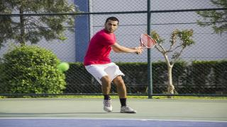 Because the speed of the ball has increased on the tennis court these days, it is a natural reflex to back up and give yourself more time.