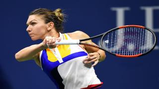 Top-seed Simona Halep cruised into the third round of Wimbledon on Thursday as she defeated China's Saisai Zheng 7-5, 6-0.