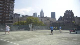 The rooftop at Midtown Tennis Club is a popular destination for players during the summer, providing a wonderful view of Midtown Manhattan.
