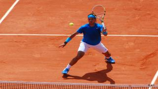 Rafael Nadal advanced into the Round of 32 at the French Open Thursday afternoon, a straight-sets winner over Argentina's Guido Pella, 6-2, 6-1, 6-1