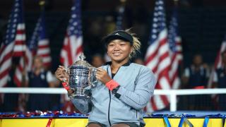 Naomi Osaka hoists the trophy after winning the 2018 US Open. last September.