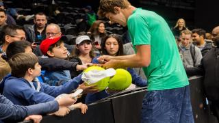 2019 New York Open champion Reilly Opelka signing autographs for fans inside Nassau Coliseum. The New York Open is moving to Dallas starting in 2022.