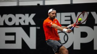 Steve Johnson came back from a set down to beat Tennys Sandgren in the opening round of the New York Open on Monday night.